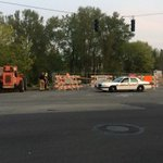In Tacoma. Vehicle drove through guardrail next to construx zone, fell 100 ft into train tracks. Driver killed http://t.co/RSr9fPlHCx