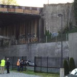 Car drives off overpass of Tacoma Avenue over rr tracks at S. Tacoma Way. http://t.co/VcJ7xHtbXs