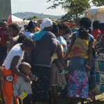 Mothers and their babies queue to receive food, diapers, matresses at Phoenix camp. #xenophobicattacks #SABCNews http://t.co/1ZCYk149Pr