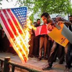Love-Hate relationship: Young Iranian burns the US flag with one hand, his iPhone in the other hand. http://t.co/C4OM7ONjrM
