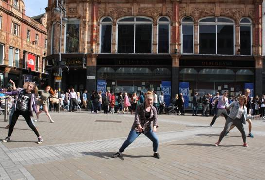 City Varieties Youth Theatre #flashmob on Briggate in #Leeds earlier today http://t.co/M8eB1PbiPr