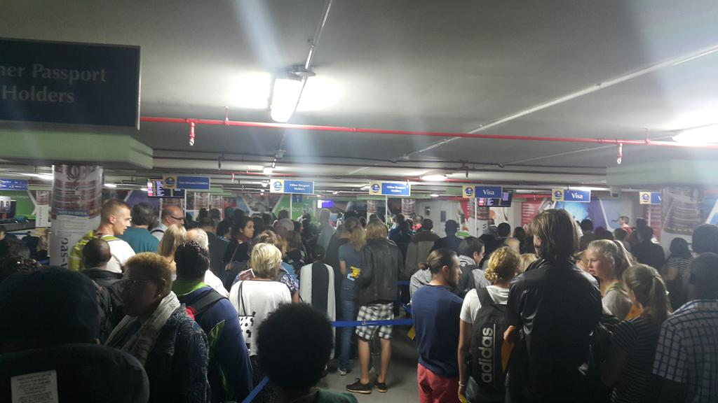 a massive Tourism problem when you arrive at JKIA you get herded like cattle on the shuttle and this is immigration http://t.co/sjqi4Gl0gQ