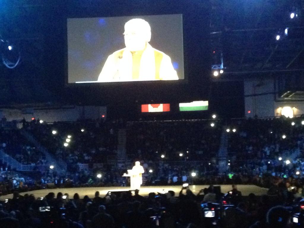 Crowd goes crazy for @narendramodi and his charisma holds the attention of all. @PMOIndia #ModiinCanada http://t.co/aQKnJuwAPZ