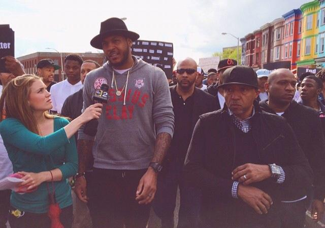 Michael Lee (@MrMichaelLee): Carmelo Anthony marching with record exec Kevin Liles - no, that isn't Russell Simmons, CNN - in Baltimore http://t.co/RpjwZs1tNh #knicks