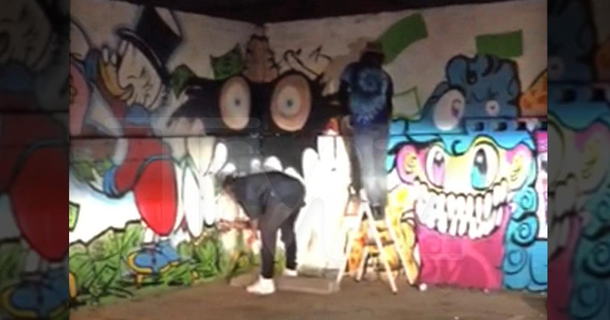 WATCH: Chris Brown graffitis the crap out of a parking lot