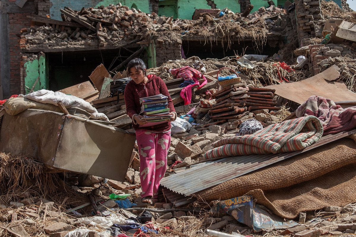 A girl salvages books from her collapsed house in Harisiddhi, Nepal, after the April 25 earthquake. (Getty Images) http://t.co/GRdkBBlLue