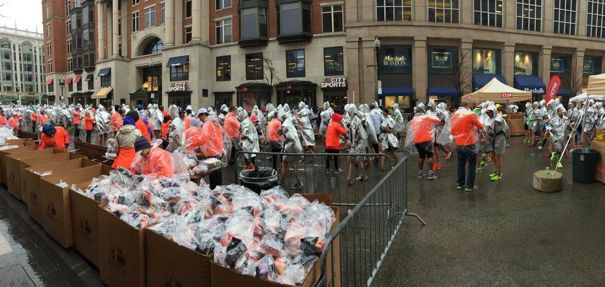These people just ran 26.2 miles through the rain and cold. Now, #marathonswag. #bostonmarathon w/ @lorenzoferrigno http://t.co/HAddbfMf0M