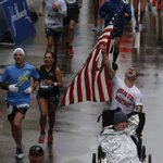 A runner wearing a @BostonFire shirt celebrates finishing the @bostonmarathon http://t.co/nQjcZrBPBT #BostonStrong http://t.co/nMXekt819Z