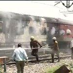 Train catches fire at New Delhi Railway station http://t.co/vrGxSu7JXP http://t.co/OjKldzw26N