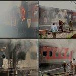 Delhi-Rajdhani Bhubaneswar Express & Sealdah Rajdhani Express catch fire at New Delhi Railway station yard http://t.co/4CsZNjs9DY