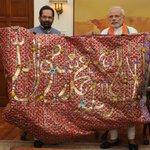 "PM Modi hands over the ""Chaadar"" to be offered at Dargah of Khwaja Moinuddin Chishti, Ajmer Sharif. Image: PIB http://t.co/M0zbwFVOJf"