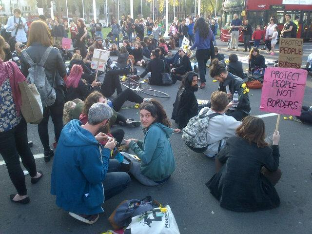 Parliament Square blocked by sit-down protest about detention centres http://t.co/KTWNYBbwpb