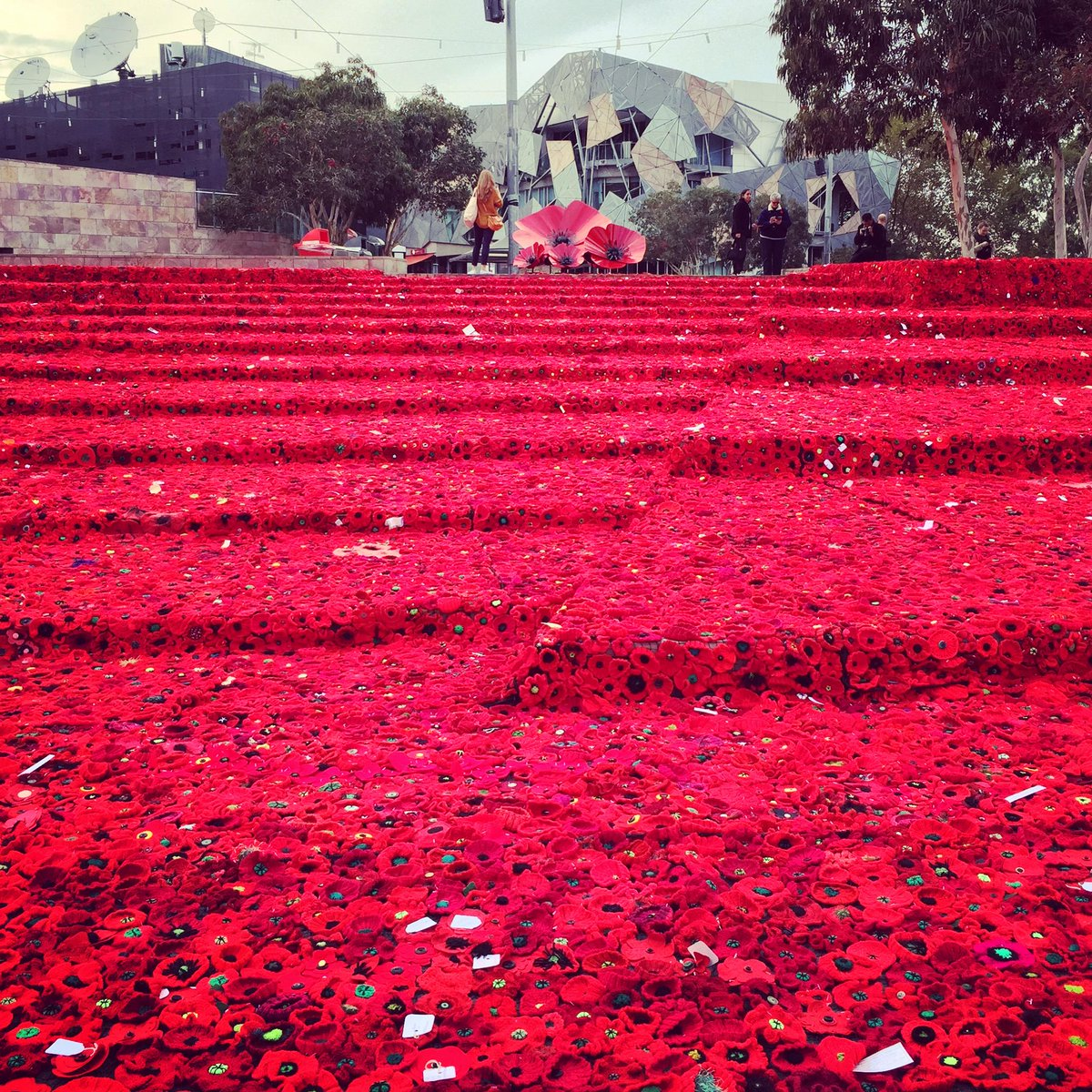 .@Fed_Square has been filled with crotchet poppies to commemorate #AnzacDay. More info: http://t.co/qOEU8Hi1mK http://t.co/spiOrvu82k