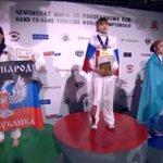Украинская спортсменка вышла на церемонию награждения с флагом ДНР ВИДЕО http://t.co/2fMlekTIUR http://t.co/w8LzKwAaq3
