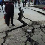 Some roads in Kathmandu have developed massive cracks as 7.5 magnitude earthquake hits Nepal http://t.co/dEr4sm7HWD http://t.co/NQ4Wimcwso