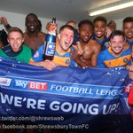 WE ARE GOING UP: #Shrewsbury Town players celebrate promotion to @SkyBetLeague1, a reward for their hard work! #Salop http://t.co/363IbxO5qc