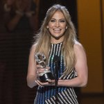 RT @JustJared: Congrats to @JLo on her Hero award at the #RDMA. She looks so thrilled with award in this pic: http://t.co/a8KiKY736n http:/…