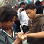 This woman is writing a number on kids arms that she told them they can call in case they get arrested #FreddieGray http://t.co/tqXrx6gfb3