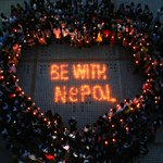 Students from University of South China in Hengyang City light candles and pray for people trapped in #Nepal #quake http://t.co/PnigJ76rKu