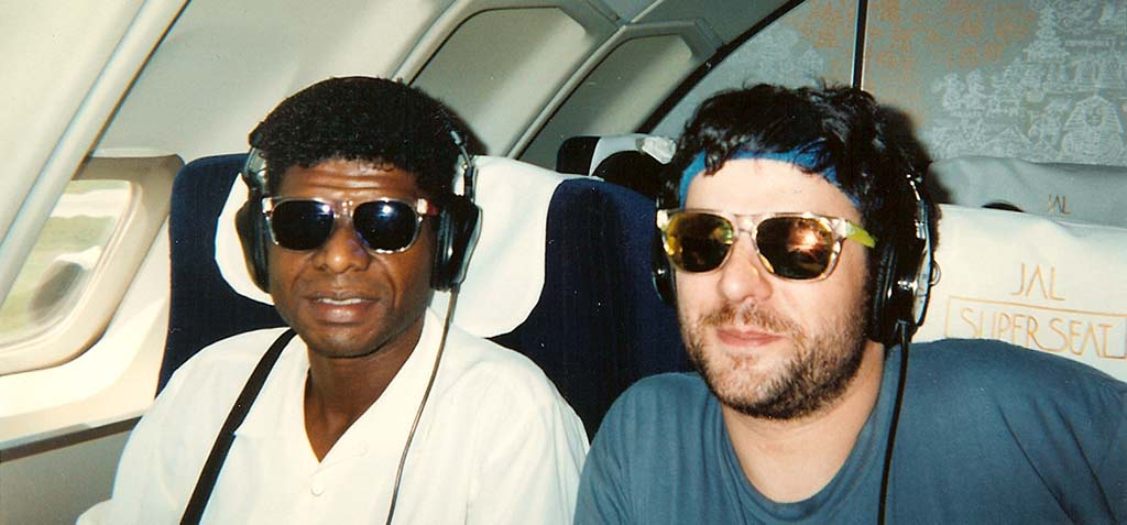 """Larry Levan and myself on a flight to Okinawa during the """"Harmony Tour"""" in Japan, September 1992. http://t.co/UNEMJHbw2s"""