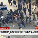 #Breaking: Reports of bricks & bottles being thrown at police in #Baltimore. Live coverage: http://t.co/wJSgobnXF1 http://t.co/Bp3yhKlPtg