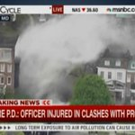 Right now in Baltimore: police in riot gear are clashing with protestors throwing rocks http://t.co/BWlgvF16jH http://t.co/cOIMa6RcoB