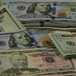 Dólar cai e opera perto de R$ 2,90 em dia de volatilidade http://t.co/GHRf6rQEYE http://t.co/AQX4mDqjyk