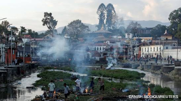 """Cremation in Nepal. """"Losing you has turned my heart to stone,"""" chants a farmer http://t.co/nxHOjqTYYx http://t.co/9JkBE3sKB9"""