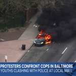LIVE: Police vehicle set on fire in Baltimore; looting ongoing at a CVS Pharmacy: http://t.co/YoGbFPeee6 http://t.co/xWyBZotf1H