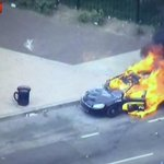 MD police cruiser on fire. Were in continuous LIVE coverage: http://t.co/mO75fnRiRO #BaltimoreRiots #FreddieGray http://t.co/f7RJozyguK