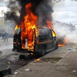 Police van on fire as well as car on W North #Baltimore #BaltimoreRiots http://t.co/SYuurFzUbG