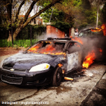 Law enforcement vehicles burn after being set on fire by demonstrators amid ongoing clashes with police in Baltimore. http://t.co/kcQLFwFLN4