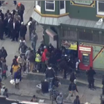 (1) Rioters topple windows at convenience store (2) Armored vehicles race down street to control crowd #Baltimore http://t.co/XDCBiCHHIz