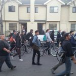 People watching from doors, some joining in as Oakland protesters continue marching through Acorn #FreddieGray http://t.co/vxL2MRVK8I