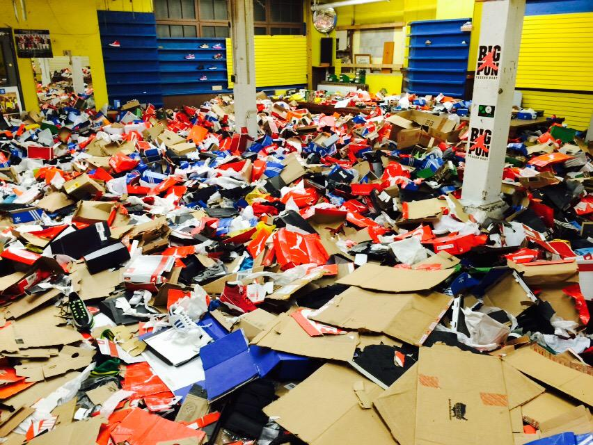 Looted shoe store in East Baltimore.  #BaltimoreRiots http://t.co/rSUrwpP6PV