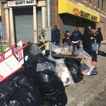 Garbage left from last nights looting now bagged up on corner of N Ave & Penn Ave thanks to group of city residents. http://t.co/yDBmrp24bO