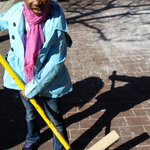 With broom in hand, 7 year old Naloni, is helping in the clean up of Penn North. @cbsbaltimore http://t.co/ocZqgGZ9SF