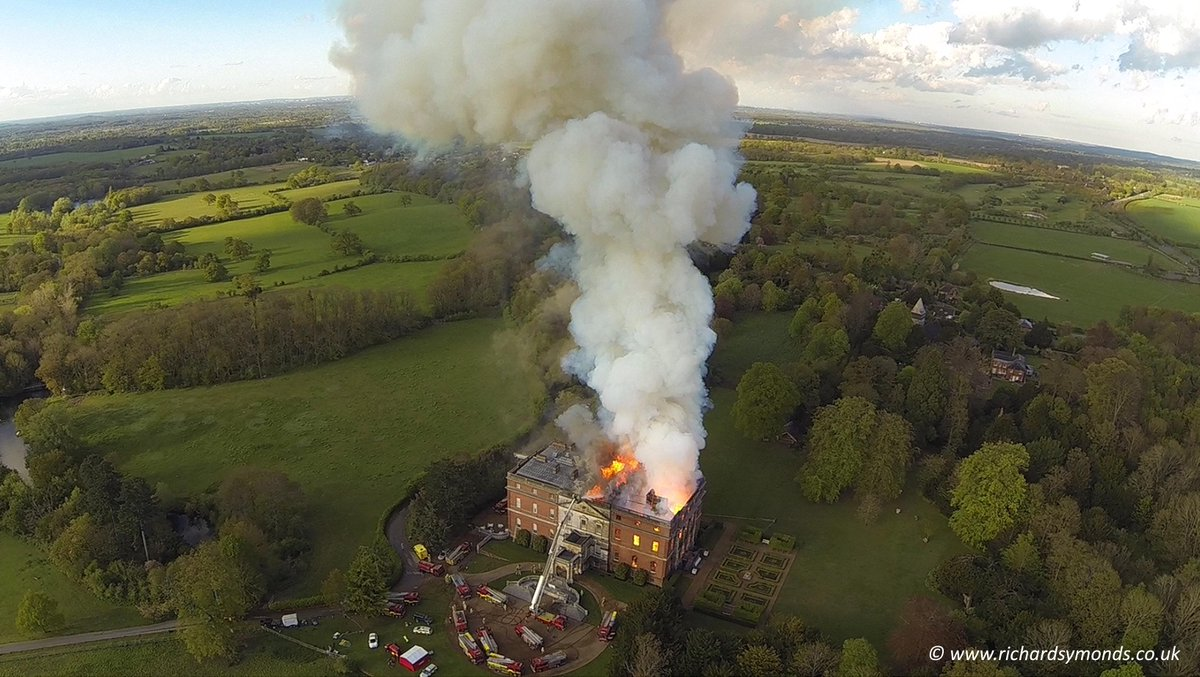 Aerial footage shows flames roaring through the roof of Clandon Park. Blaze is sill going. http://t.co/oJPRgHcCc8 http://t.co/UO0iaH03Wc