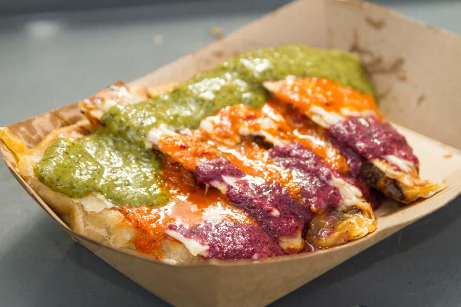 A rainbow of sauces, all 3 meats, melty cheese. Who's gonna let their freak flag fly today? #PacmanQuesadilla http://t.co/z89M0Ug9si