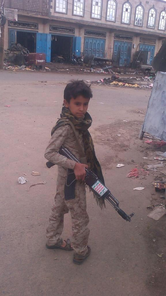 Are they serious? #Houthi child soldier full uniform and weapon with Houthi slogan. #yemen #houthicrimes http://t.co/G13W1AosCF