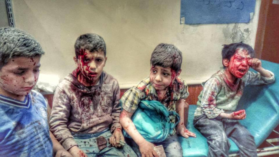 He still holds his backBag n hospital. 4 boys survived ydy's massacre as barrel bomb hit their school #Aleppo #Syria http://t.co/1g4l1AgL8b