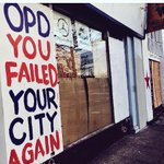 Sign at #Oakland business criticizing @oaklandpoliceca response to #MayDay protest vandals. http://t.co/L3KENAyxmw