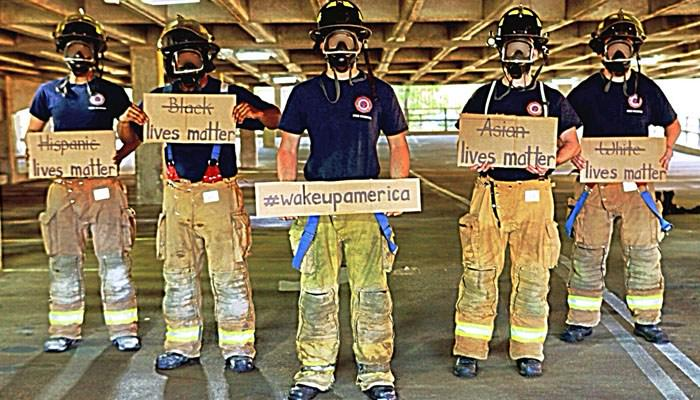 A photo featuring Memphis firefighters is going viral. See the story behind the photo: http://t.co/b2JBiCiYSZ http://t.co/FjO04nYnbx