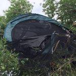 Wow! - Trampoline stuck in tree near MLK & Lyons, blew all the way from neighbors yard #okwx @OKCFOX http://t.co/lg9O15n6A8