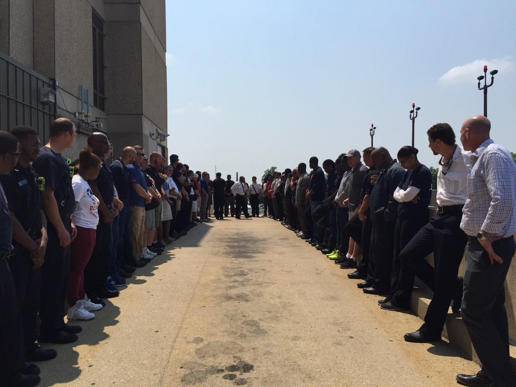 Members await the body of Lt. Kevin McRae to be carried out of the hospital. http://t.co/dFAqAYPUIp