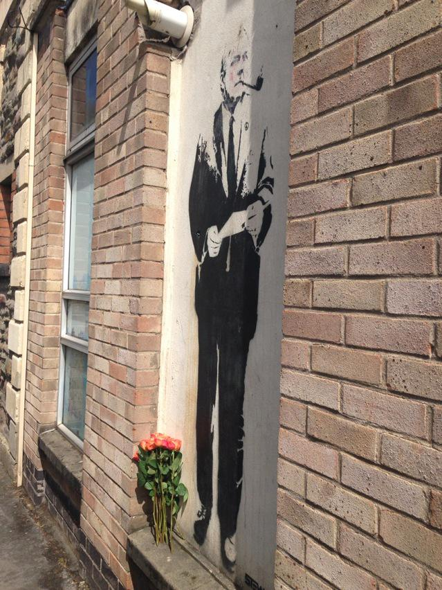 Someone has left roses by Tony Benn on my office wall. @hilarybennmp http://t.co/ErtBa8pmQ2