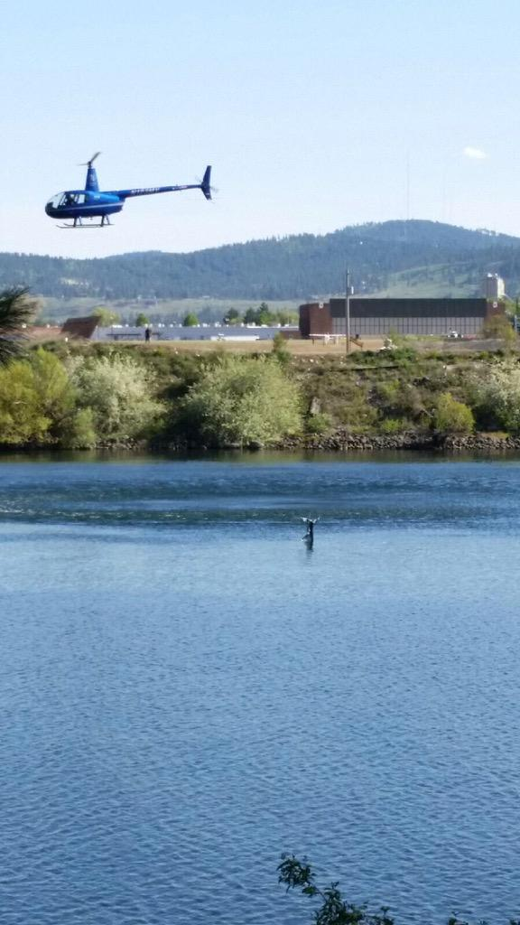 BREAKING: Plane crashes into Spokane River near Felts Field. You can see tail in pic under helicopter. #kxly http://t.co/d8aaKTCIib