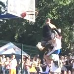 WOW. 5-foot-9 dunker jumps over 2 people & finishes it w/ this #SCtop10 between-the-legs slam. http://t.co/Nk2hEaAbLn http://t.co/xhy3jGS1bJ