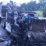 18 wheeler fire US 49 southbound north of Magee. Use caution left lane is blocked. http://t.co/TZXVop39VC