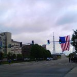 Omaha Fire Department hangs flag at 10th & Douglas for Officer Kerrie Orozco procession. @action3news #KMTV #Kerrieon http://t.co/5TfZEeTccf